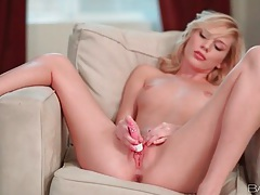 Skinny blonde buzzes her twat with a vibrator tubes