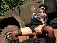 Classy clothed girl rides soldier cock outdoors tubes