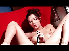 Brunette with dildo buzzes her pussy tubes