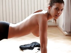 Sporty girl does pushups in skintight pants tubes