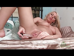 Blonde strips off red lingerie and toys her pussy tubes