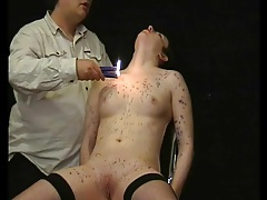 Lean body covered in dripping hot wax tubes