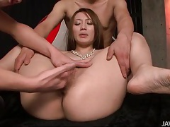 They kiss her all over and finger her japanese pussy tubes