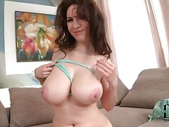 Beauty in high heels plays with her sexy tits tubes