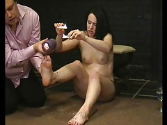 Hot wax dripping on her feet causes pain tubes