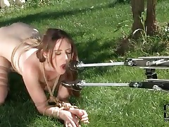 Bound girl sucking dildo outdoors tubes