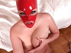 Babe in red latex mask gives pov handjob tubes