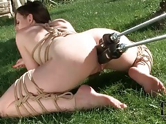 Dildo machine double penetrates bound girl tubes