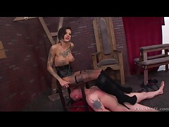 Tattooed girl in boots gets ass licked by sub tubes