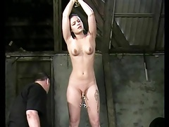 Bound girl in his dungeon takes pussy torture tubes