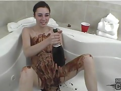 Solo teen covered in slippery chocolate sauce tubes