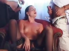 Classy slut in stockings sucks on two dicks tubes