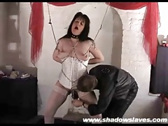 Chained up milf chick in white corset tubes