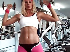 Sporty blonde shows off her tits in gym tubes