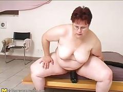 Fat chick sits on huge black didlo tubes