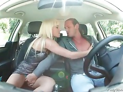 Blonde in shiny dress sucks dick in car tubes