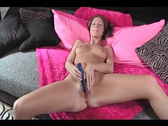 Skinny girl with shiny dildo in hand masturbates tubes