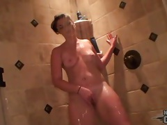 Her wet curvy body looks sexy in the shower tubes