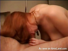 Redheaded cocksucker sits on her tight pussy tubes