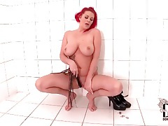 Redhead with big tits and tattoos fondles solo tubes