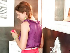 Her satin skirt and top are perfect in toy video tubes