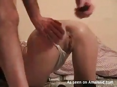 He reams her asshole as she vibrates the pussy tubes