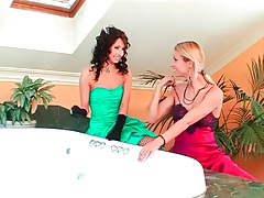 Girls in lovely dresses play in the bathtub tubes