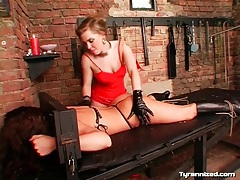 Girl bound to table and played with by mistress tubes