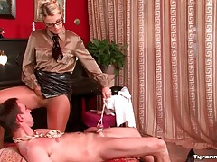 Dominant girl in leather skirt ties him up tubes