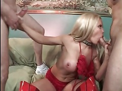 Bimbo cocksucker in shiny red latex boots tubes