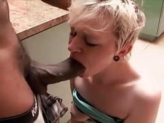 Big black cock in her mouth makes slut gag tubes