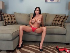 Solo brunette with big fake tits gets naked tubes