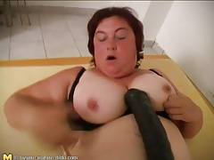 Fatty fucks her vagina with her huge dildo tubes