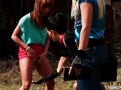 Four girls on a picnic blanket have lusty fun tubes