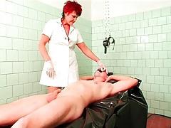 Mature nurse in gloves fingers his asshole tubes