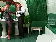 Bathroom attendant cleans up as mistress watches tubes