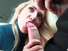 Blonde in turtleneck gives blowjob in car tubes