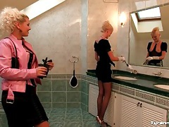 Maid and mistress play in the bathroom tube