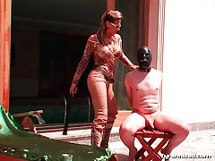 Mistress in boots steps on his cock outdoors tubes