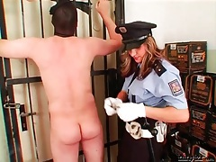 Femdom cop flogs and canes the submissive guy tubes