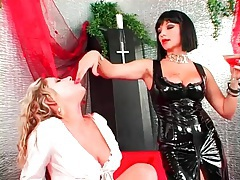 Mistress in black and submissive in white at play tubes