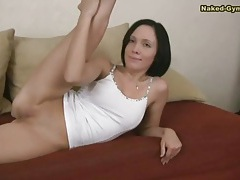 Shaved girl in socks shows her flexibility tubes