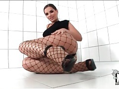 Little black dress and sexy fishnet pantyhose tubes
