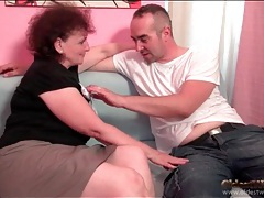 Old lady wraps her lips around his hard dick tubes