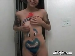 Teen camgirl shows off body paint and tattoos tubes