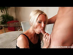 Arousing blowjob from sexy milf in black tubes