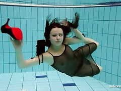 Brunette jumps in the pool fully dressed tubes