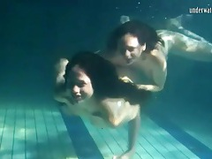 Underwater workout and fun with two beauties tubes