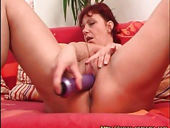 Mature redhead slides dildo into her cunt tubes