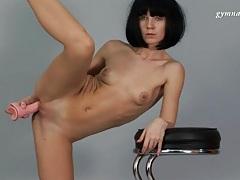 Flexible ballerina fucks pussy with dildo tubes